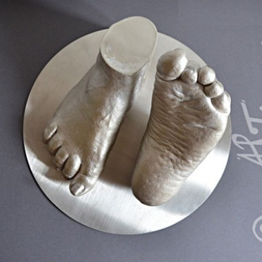 Woman feet in stainless steel style
