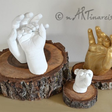 Hands installations on solid wood base