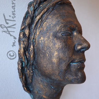 woman plaster face cast in bronze finish